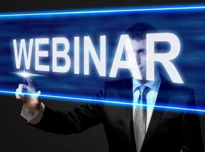 WEBINAR - businessman touching blue screen
